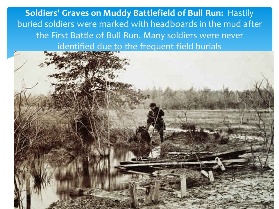 Soldiers Graves on Muddy Battlefield of Bull Run: Hastily buried soldiers were marked with headboards in the mud after the First Battle of Bull Run. Many soldiers were never identified due to the frequent field burials