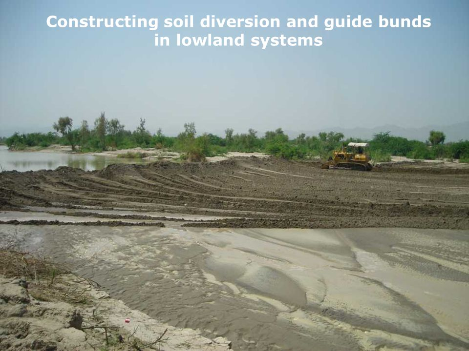 Constructing soil diversion and guide bunds in lowland systems