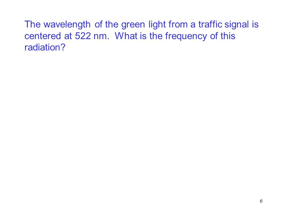 The wavelength of the green light from a traffic signal is centered at 522 nm.