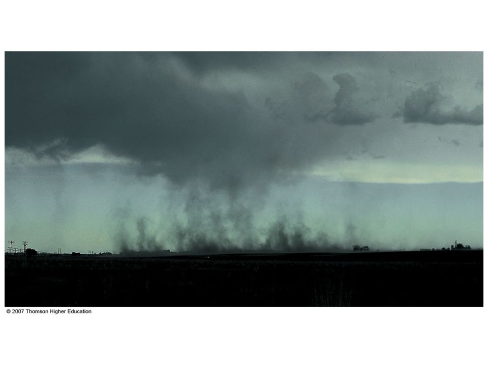 Figure 10.11: A dramatic example of a shelf cloud (or arcus cloud) associated with an intense thunderstorm. The photograph was taken in the Philippines as the thunderstorm approached from the northwest.