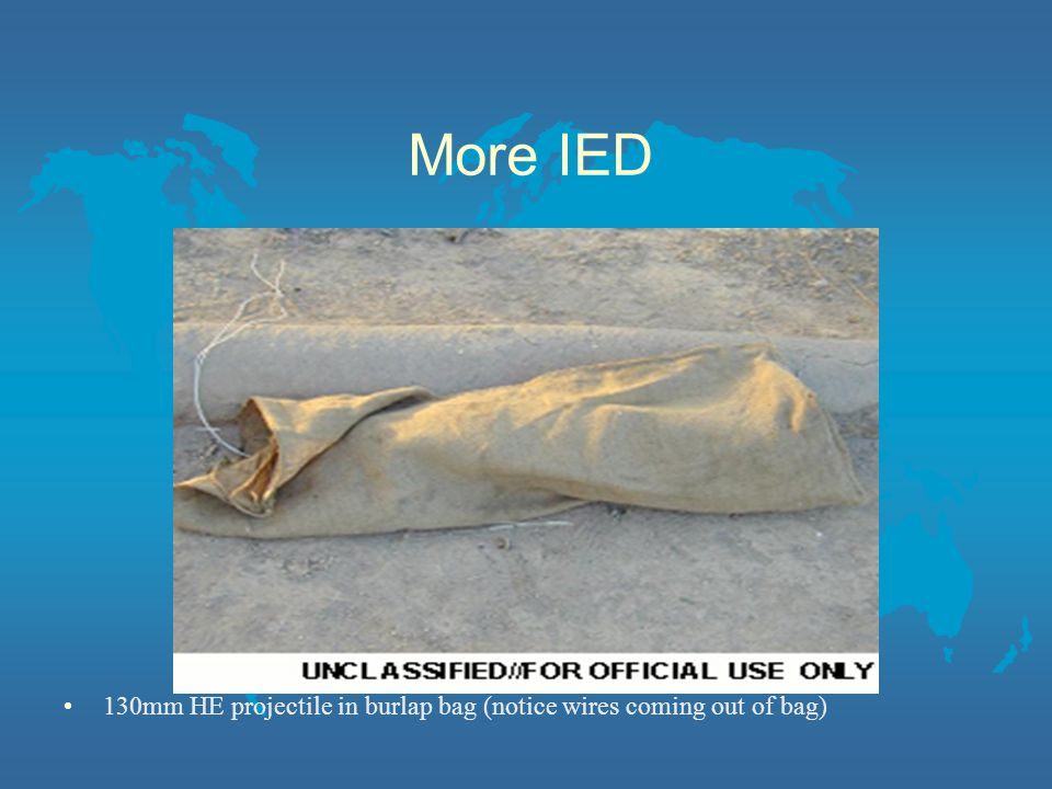 More IED 130mm HE projectile in burlap bag (notice wires coming out of bag)