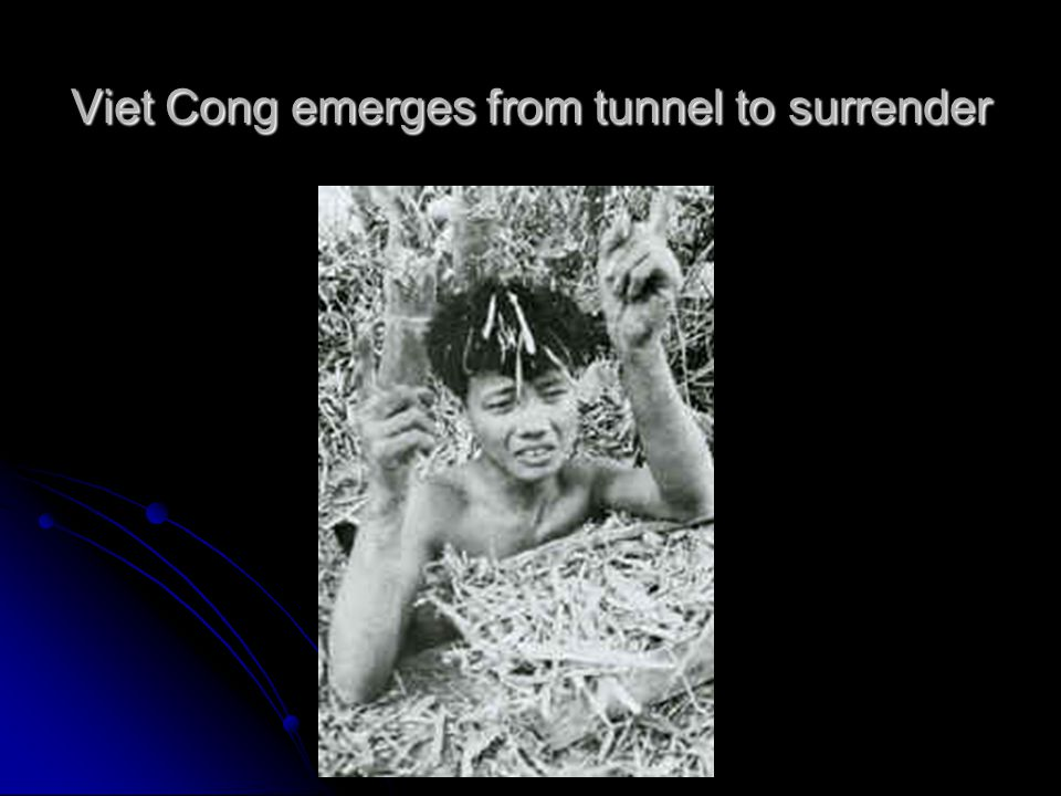 Viet Cong emerges from tunnel to surrender