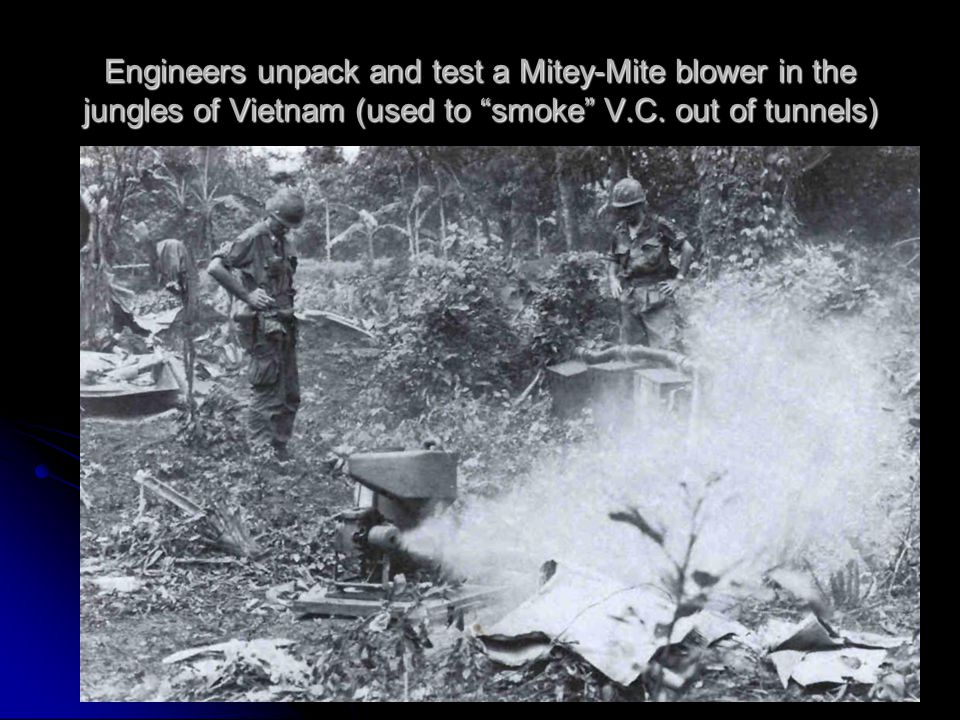 Engineers unpack and test a Mitey-Mite blower in the jungles of Vietnam (used to smoke V.C.
