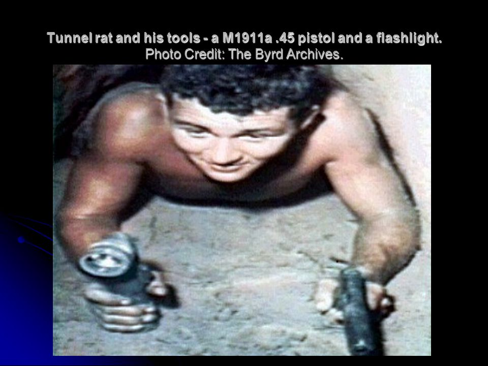Tunnel rat and his tools - a M1911a. 45 pistol and a flashlight