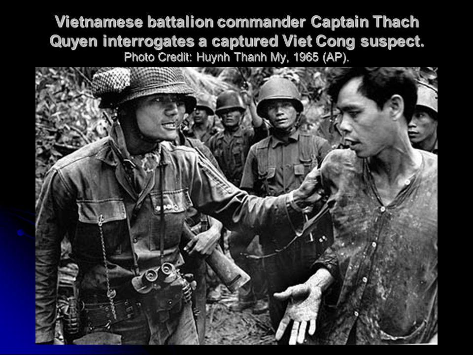 Vietnamese battalion commander Captain Thach Quyen interrogates a captured Viet Cong suspect.