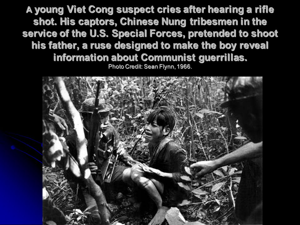 A young Viet Cong suspect cries after hearing a rifle shot