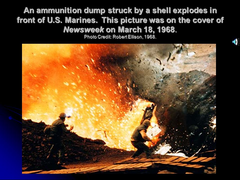 An ammunition dump struck by a shell explodes in front of U.S.