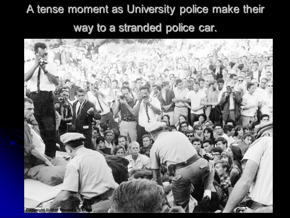 A tense moment as University police make their way to a stranded police car.