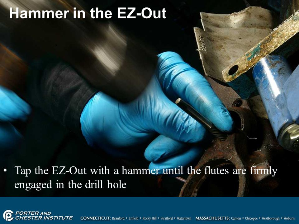 Hammer in the EZ-Out Tap the EZ-Out with a hammer until the flutes are firmly engaged in the drill hole.