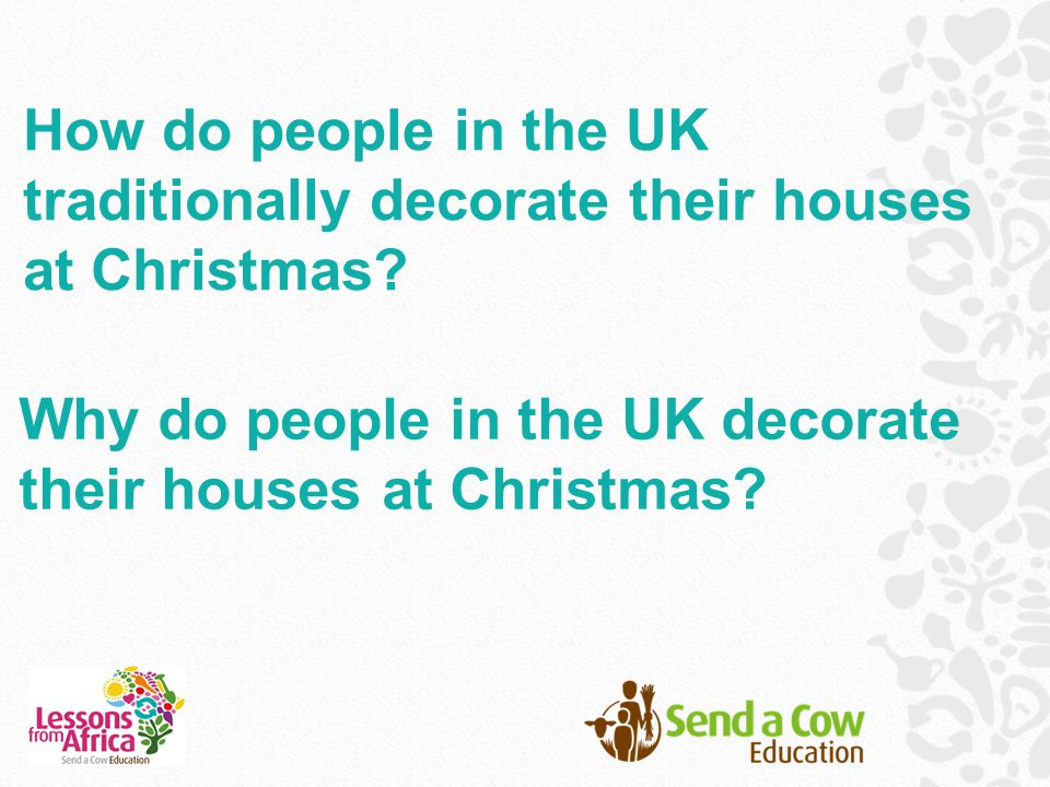 How do people in the UK traditionally decorate their houses at Christmas