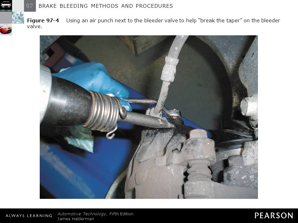 Figure 97-4 Using an air punch next to the bleeder valve to help break the taper on the bleeder valve.