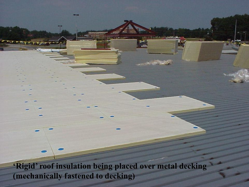 'Rigid' roof insulation being placed over metal decking
