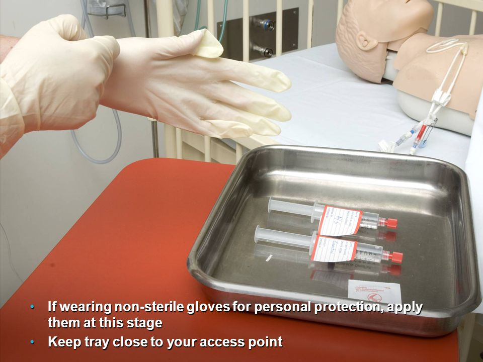 If wearing non-sterile gloves for personal protection, apply them at this stage