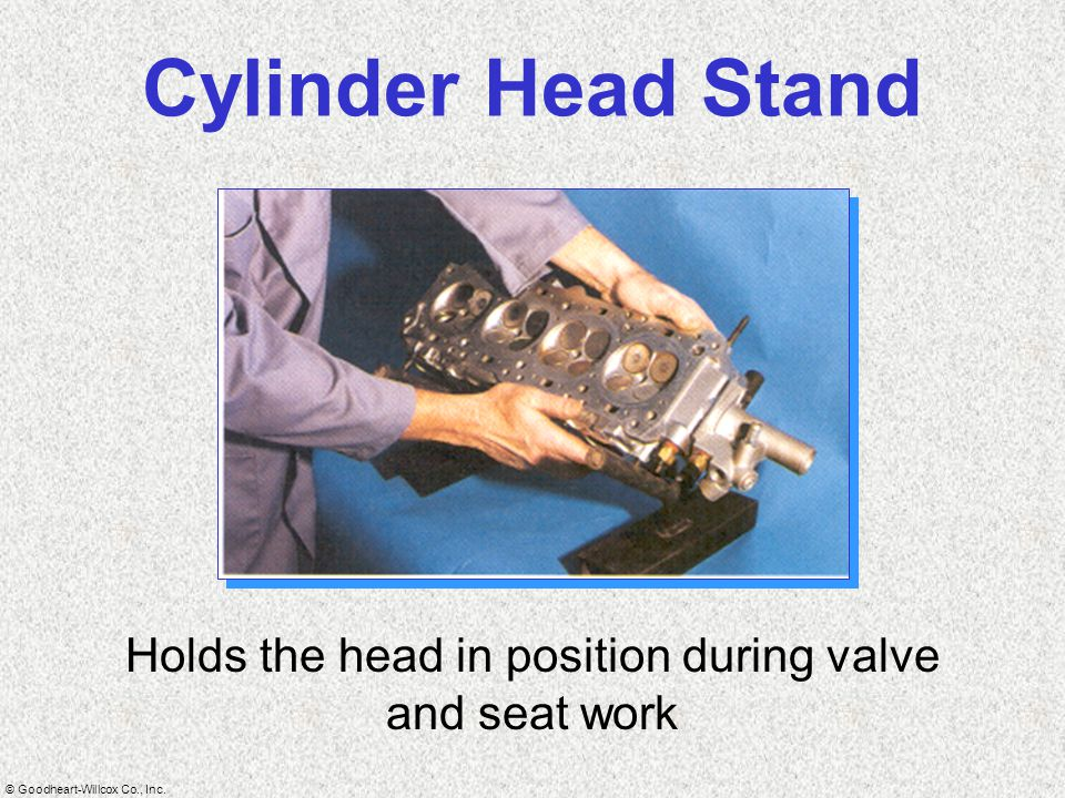 Holds the head in position during valve and seat work