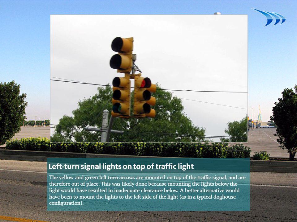 Left-turn signal lights on top of traffic light