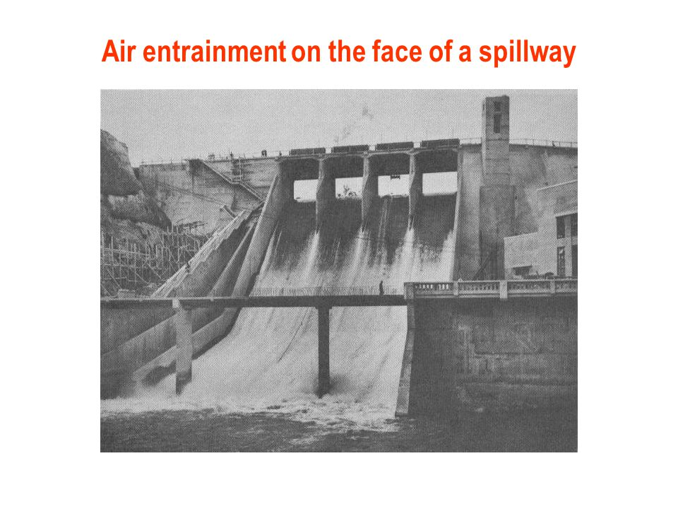 Air entrainment on the face of a spillway