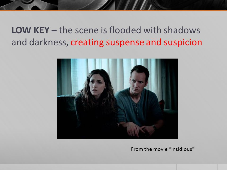 LOW KEY – the scene is flooded with shadows and darkness, creating suspense and suspicion