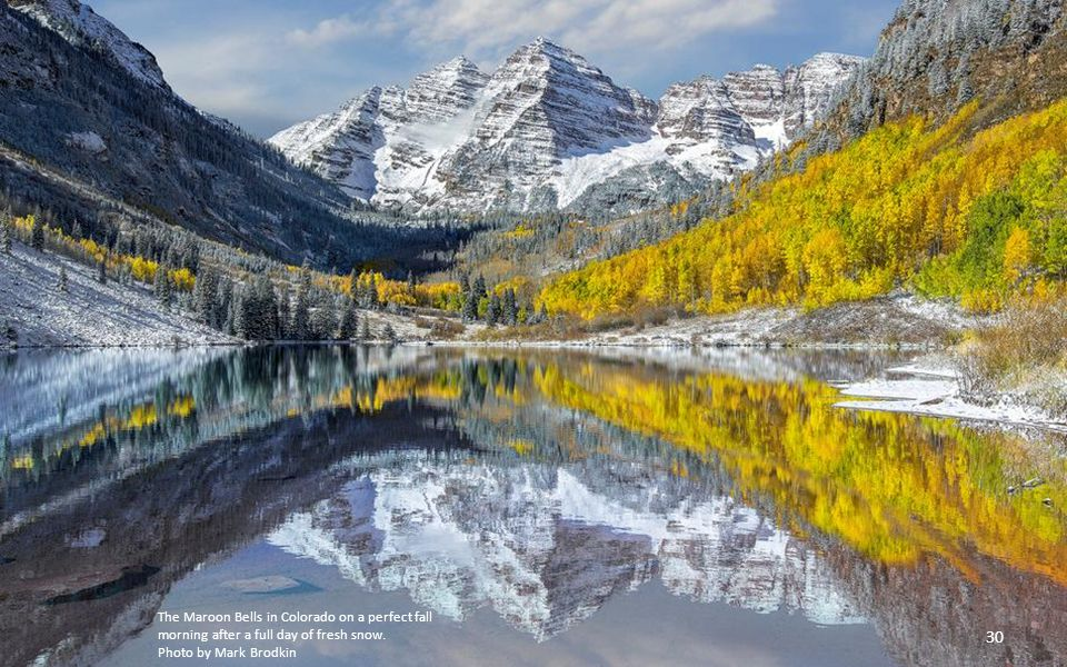The Maroon Bells in Colorado on a perfect fall morning after a full day of fresh snow.