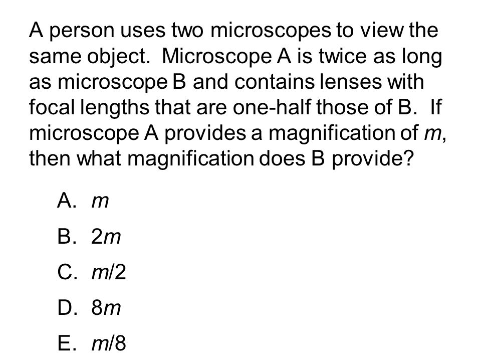 A person uses two microscopes to view the same object