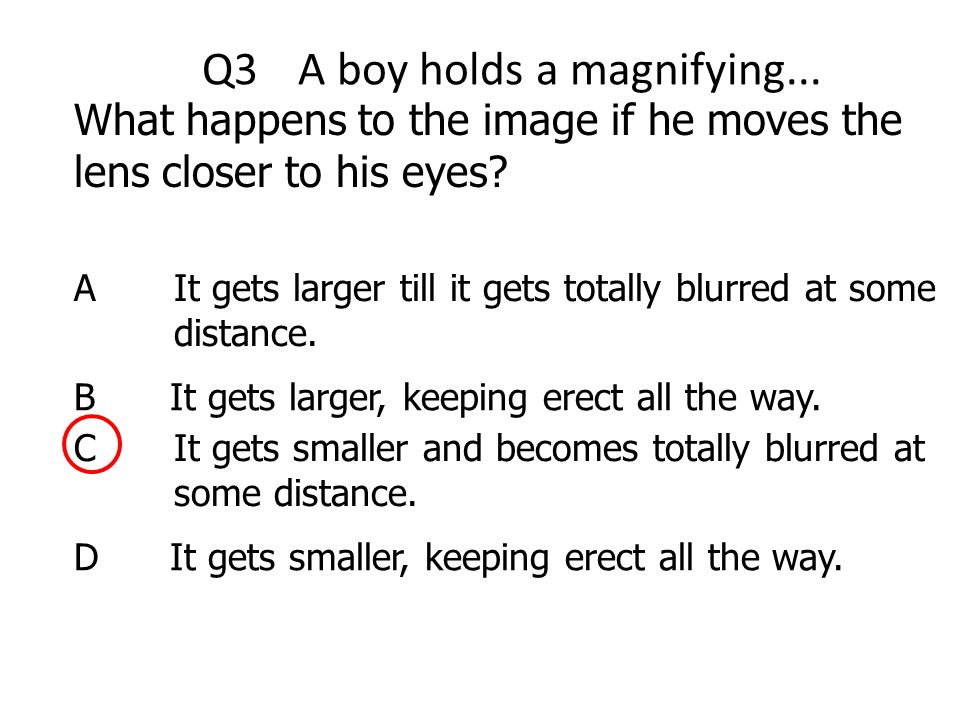 Q3 A boy holds a magnifying...