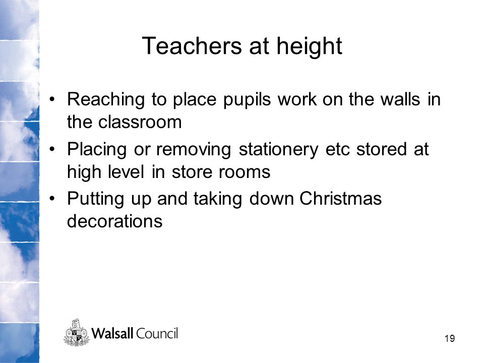 Teachers at height Reaching to place pupils work on the walls in the classroom.