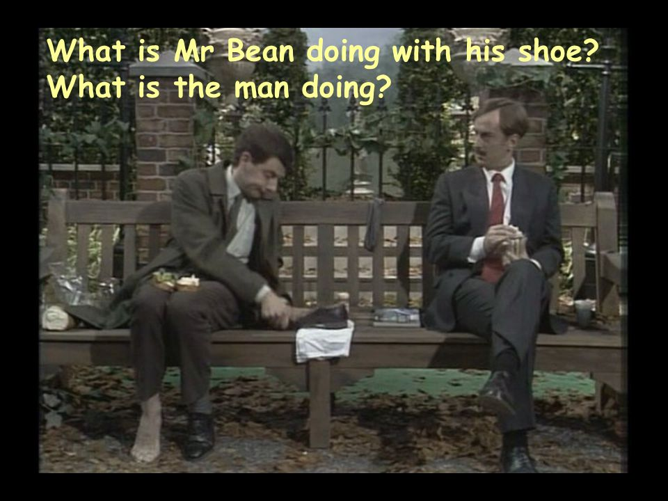 What is Mr Bean doing with his shoe