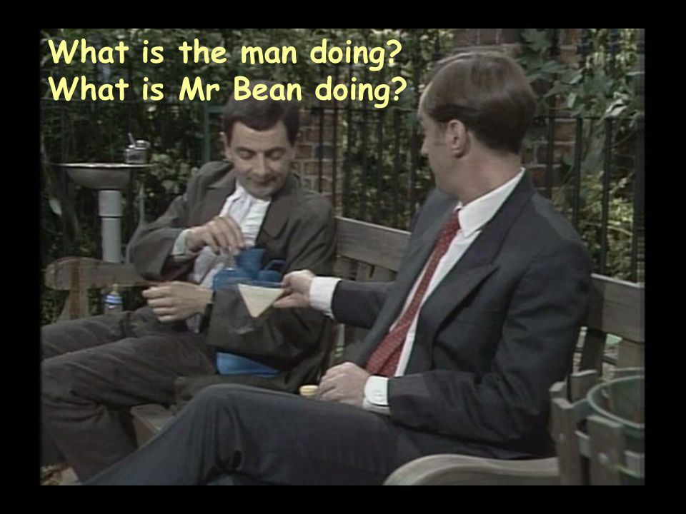 What is the man doing What is Mr Bean doing
