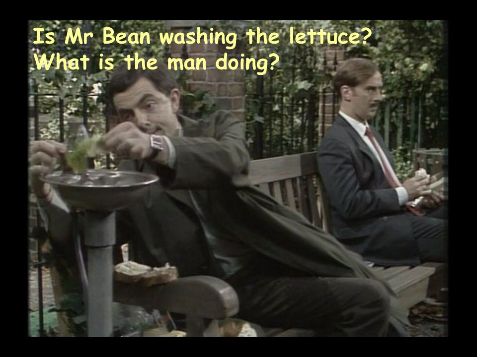 Is Mr Bean washing the lettuce