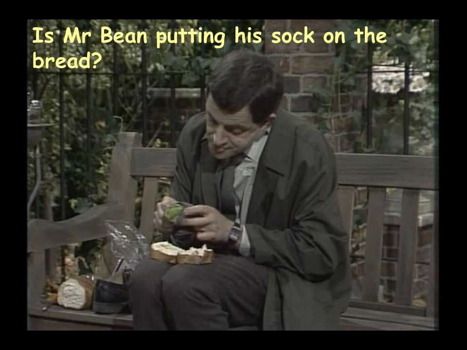 Is Mr Bean putting his sock on the bread