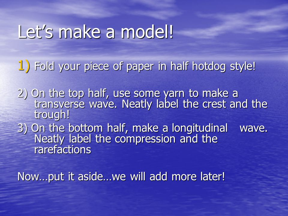 Let's make a model! Fold your piece of paper in half hotdog style!