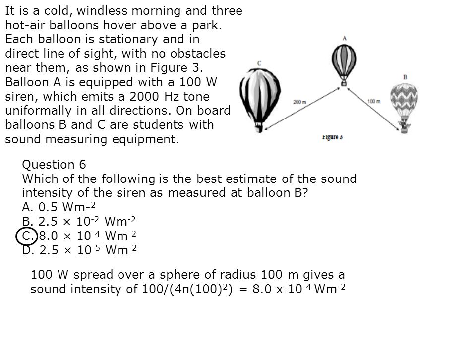 It is a cold, windless morning and three hot-air balloons hover above a park. Each balloon is stationary and in