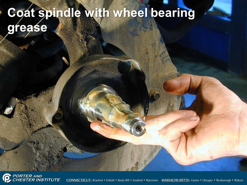 Coat spindle with wheel bearing grease