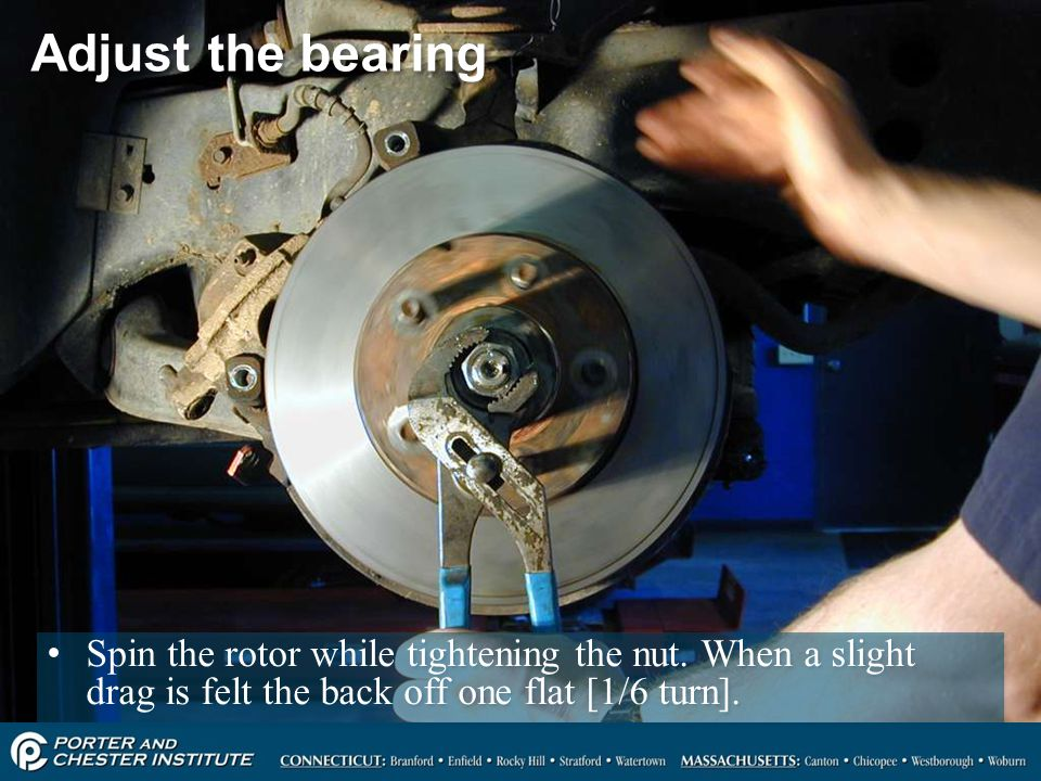 Adjust the bearing Spin the rotor while tightening the nut.