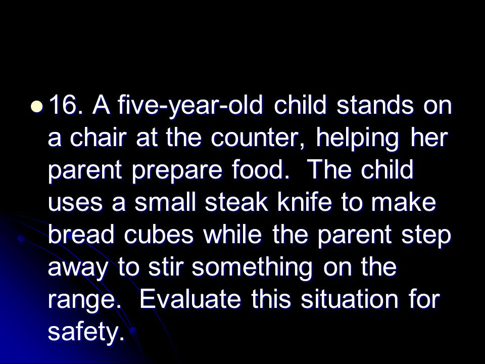16. A five-year-old child stands on a chair at the counter, helping her parent prepare food.