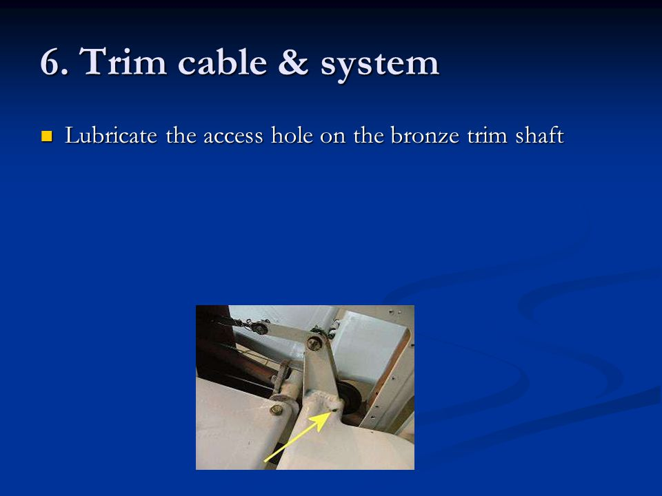 6. Trim cable & system Lubricate the access hole on the bronze trim shaft