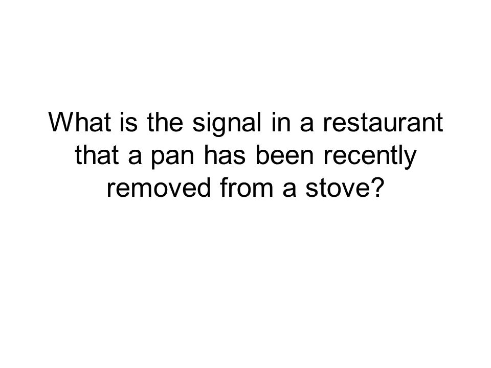 What is the signal in a restaurant that a pan has been recently removed from a stove