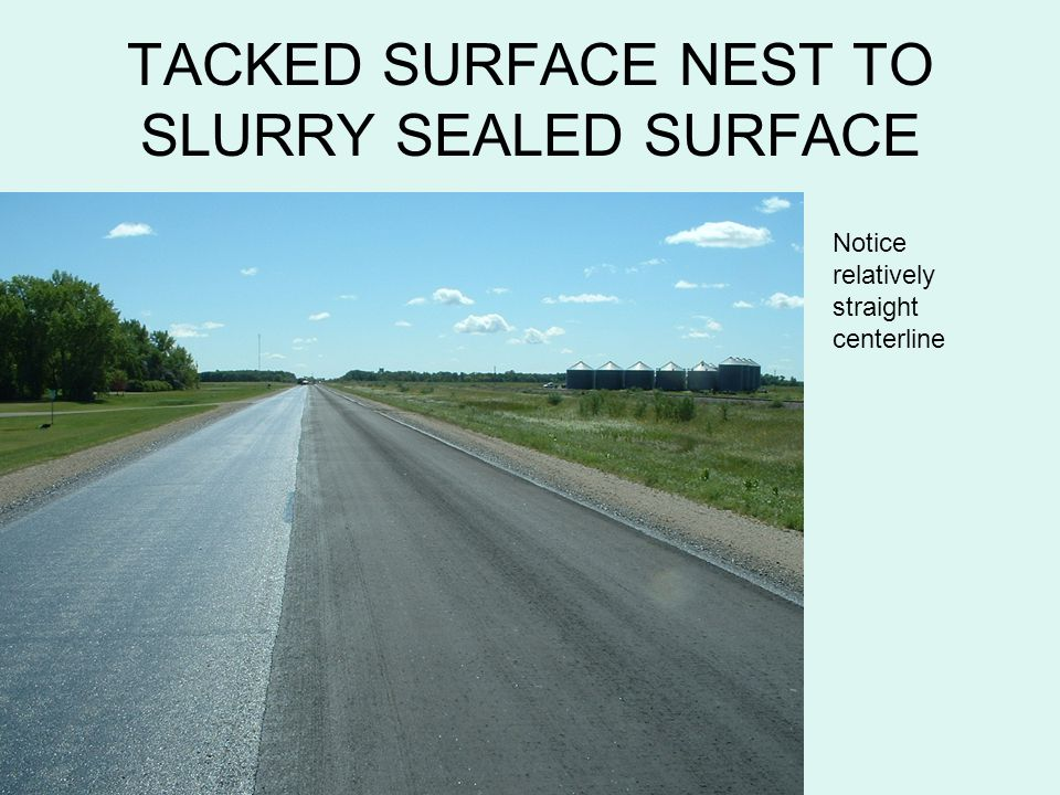 TACKED SURFACE NEST TO SLURRY SEALED SURFACE