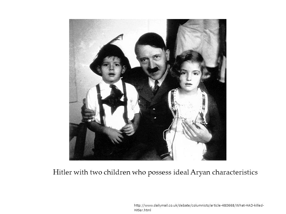 Hitler with two children who possess ideal Aryan characteristics