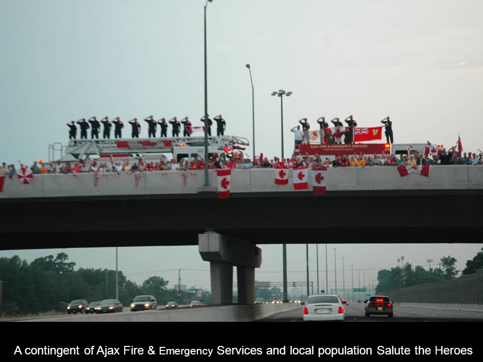 A contingent of Ajax Fire & Emergency Services and local population Salute the Heroes