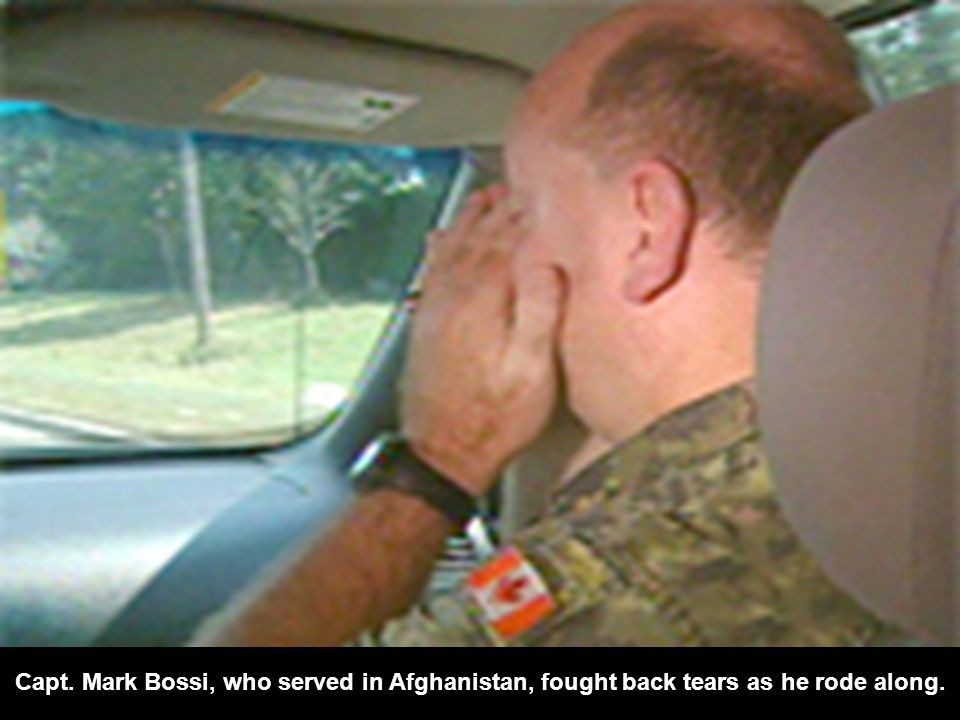 Capt. Mark Bossi, who served in Afghanistan, fought back tears as he rode along.