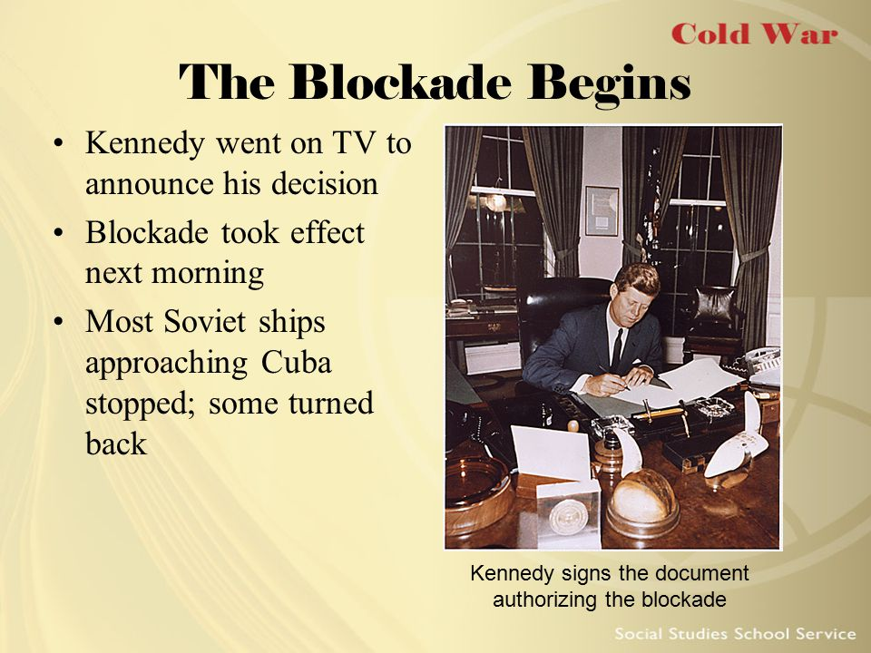 Kennedy signs the document authorizing the blockade
