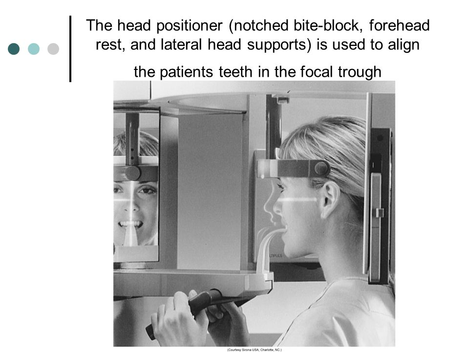 The head positioner (notched bite-block, forehead rest, and lateral head supports) is used to align the patients teeth in the focal trough