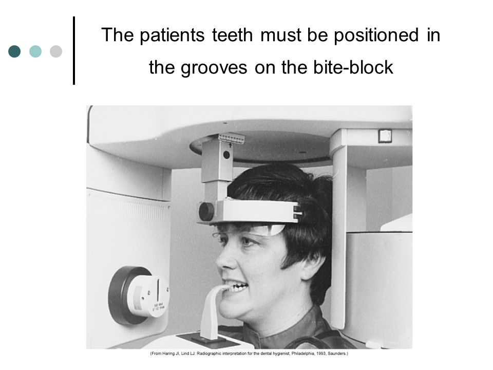 The patients teeth must be positioned in the grooves on the bite-block