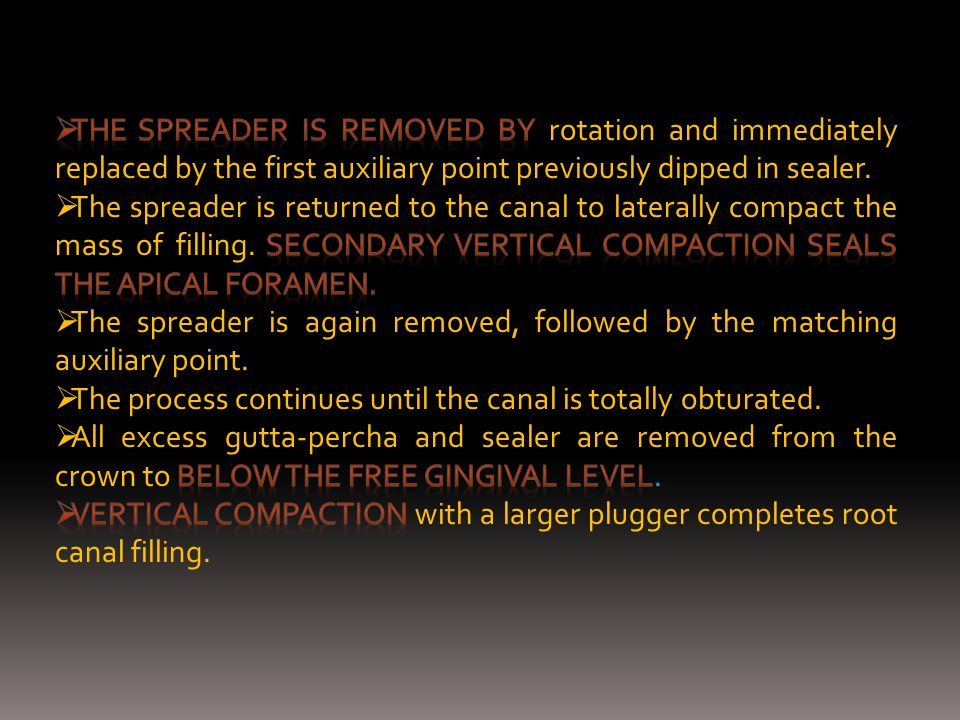 The spreader is removed by rotation and immediately replaced by the first auxiliary point previously dipped in sealer.