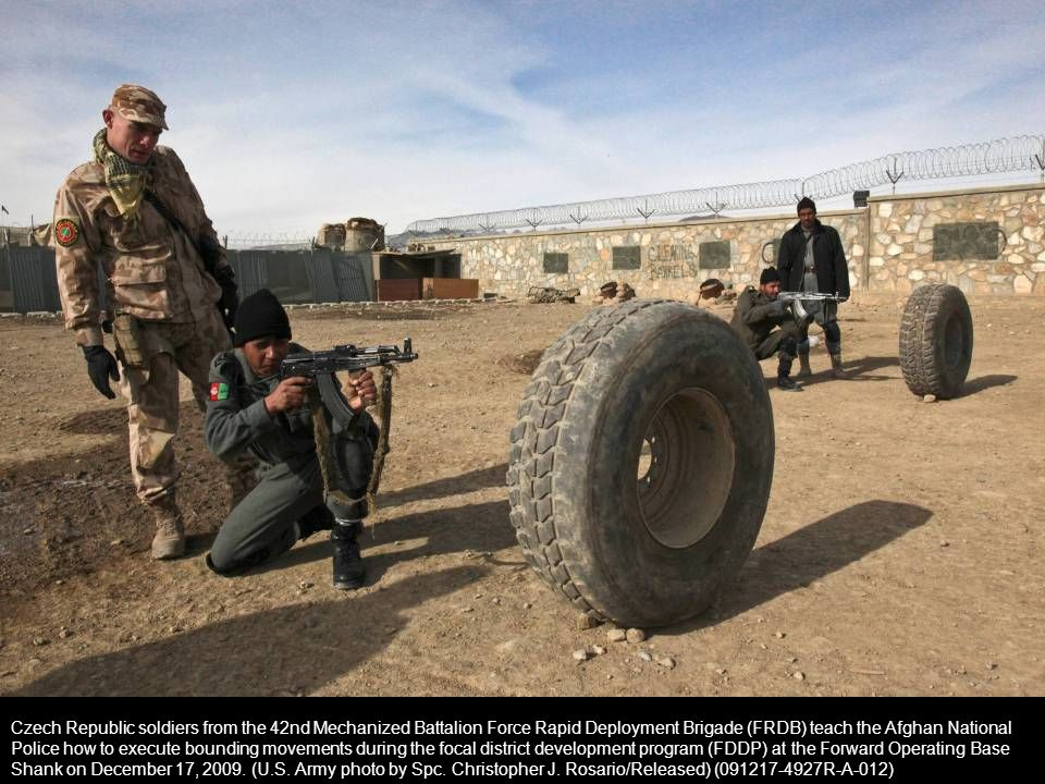 Czech Republic soldiers from the 42nd Mechanized Battalion Force Rapid Deployment Brigade (FRDB) teach the Afghan National Police how to execute bounding movements during the focal district development program (FDDP) at the Forward Operating Base Shank on December 17, 2009.