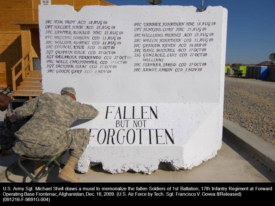 U.S. Army Sgt. Michael Shell draws a mural to memorialize the fallen Soldiers of 1st Battalion, 17th Infantry Regiment at Forward Operating Base Frontenac, Afghanistan, Dec. 16, 2009. (U.S. Air Force by Tech. Sgt. Francisco V. Govea II/Released)