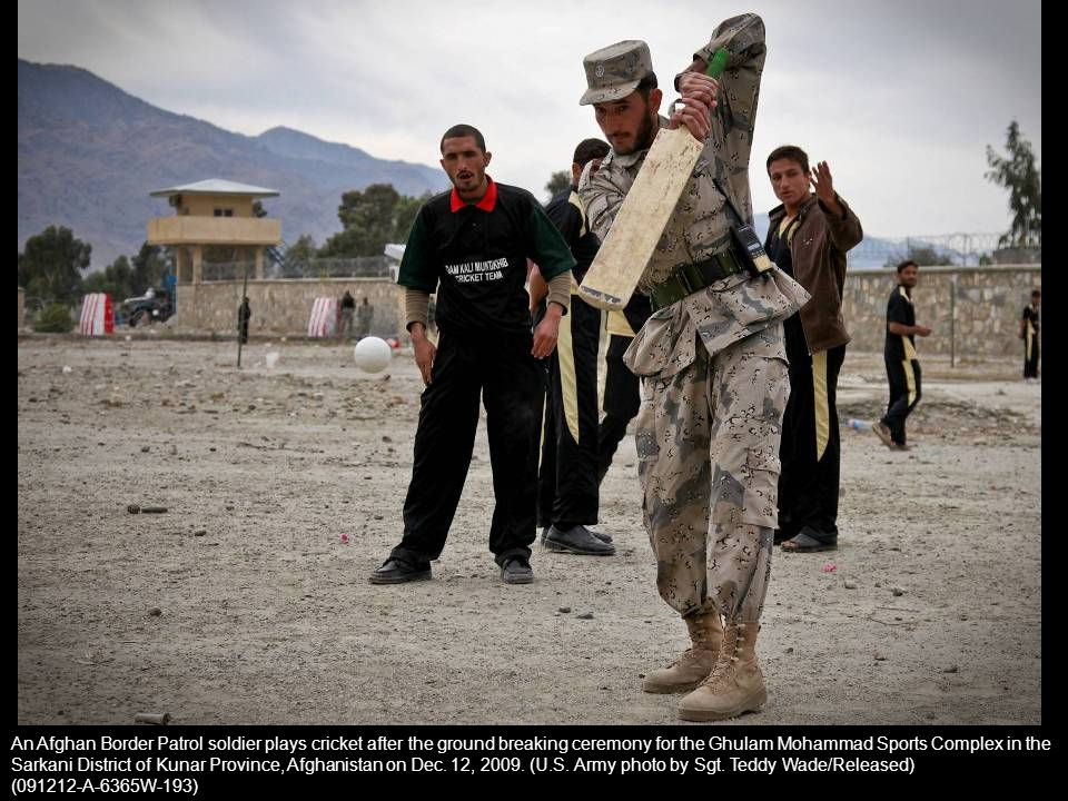 An Afghan Border Patrol soldier plays cricket after the ground breaking ceremony for the Ghulam Mohammad Sports Complex in the Sarkani District of Kunar Province, Afghanistan on Dec. 12, 2009. (U.S. Army photo by Sgt. Teddy Wade/Released)