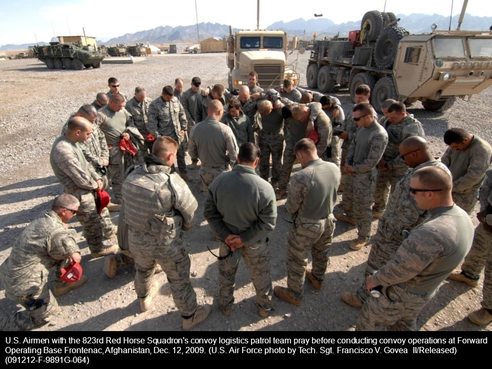 U.S. Airmen with the 823rd Red Horse Squadron s convoy logistics patrol team pray before conducting convoy operations at Forward Operating Base Frontenac, Afghanistan, Dec. 12, 2009. (U.S. Air Force photo by Tech. Sgt. Francisco V. Govea II/Released)