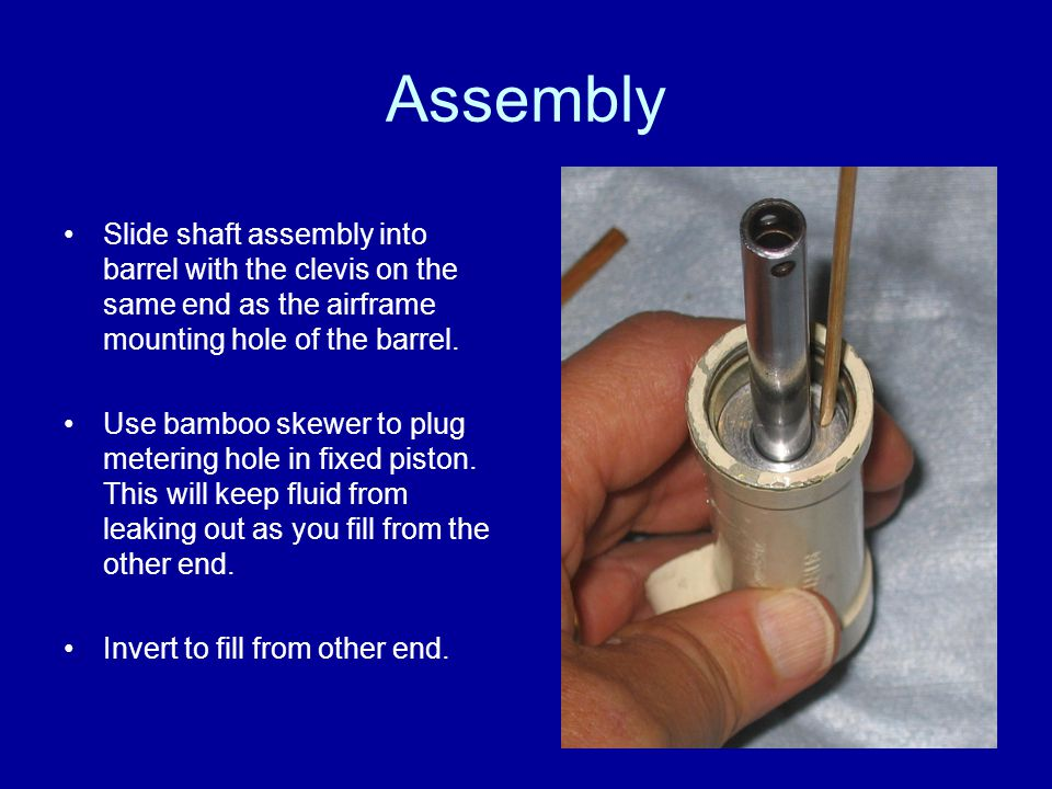 Assembly Slide shaft assembly into barrel with the clevis on the same end as the airframe mounting hole of the barrel.