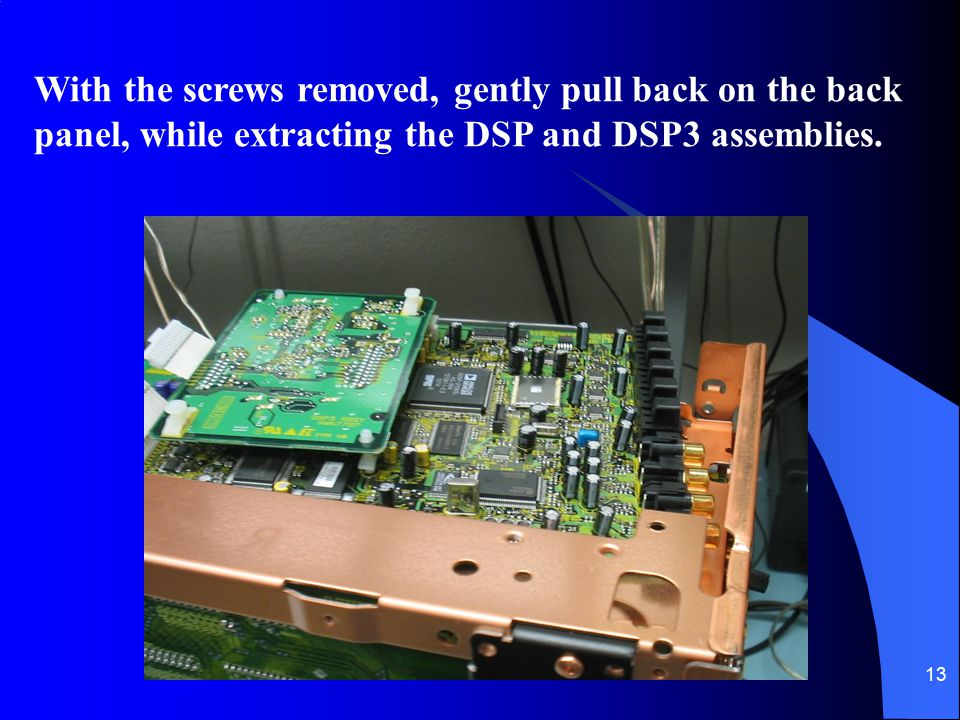 With the screws removed, gently pull back on the back panel, while extracting the DSP and DSP3 assemblies.
